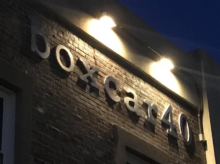 The BoxCar40 sign on the front of the brick building