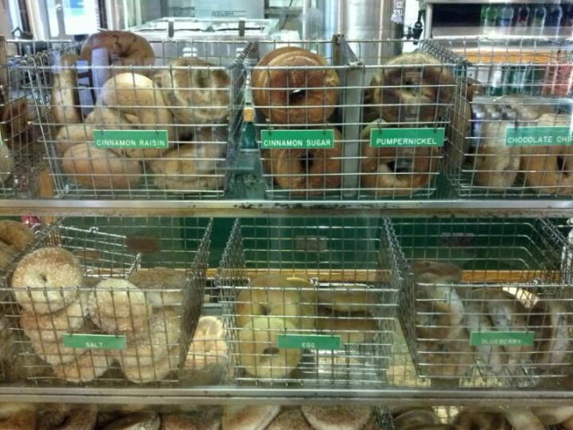 Metal baskets of assorted bagels.