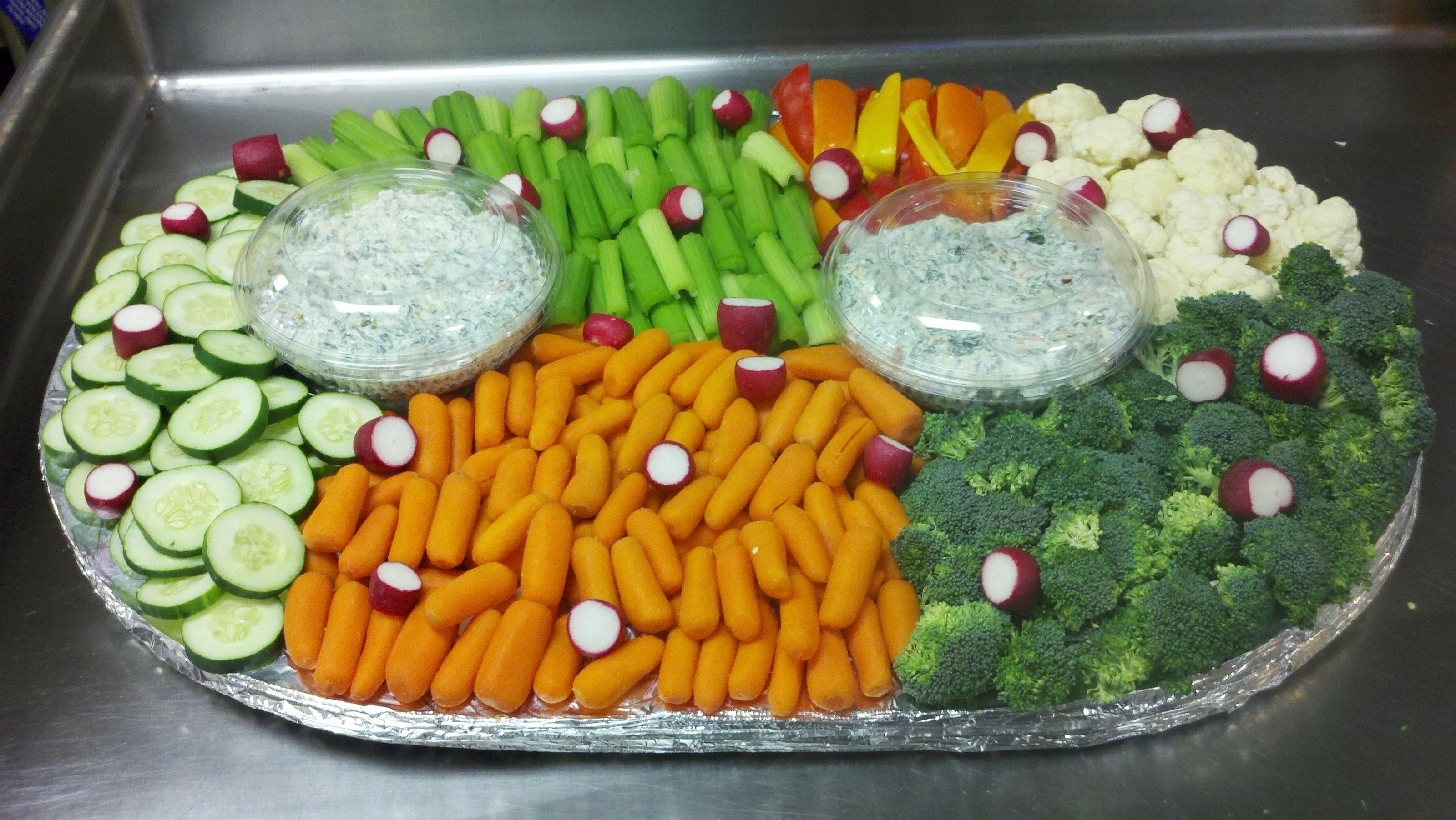 Tray of assorted vegetables with dips
