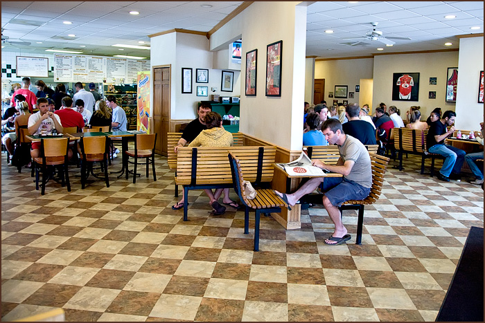 Interior of restaurant showing students eating at tables