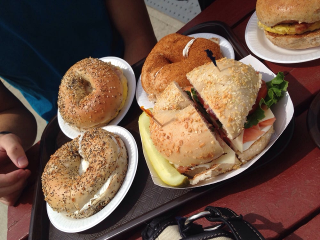 Tray with three bagels and sandwich
