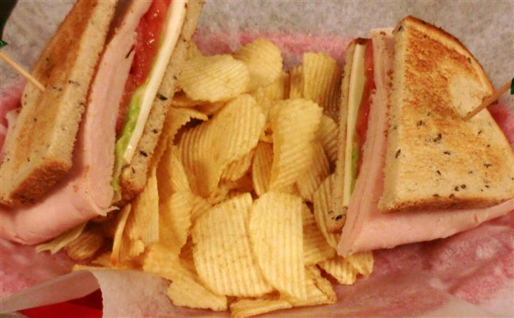 Club sandwich served with chips