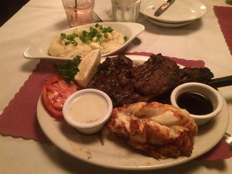 Steak with side of mashed potatoes and lobster tail