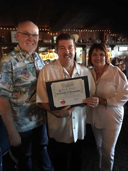 The Torrance Mayor Pat Furey, awarding Rick LoCoco the City of Torrance Certificate of Recognition