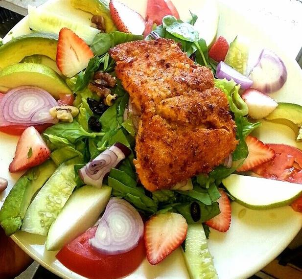 salad topped with chicken breast