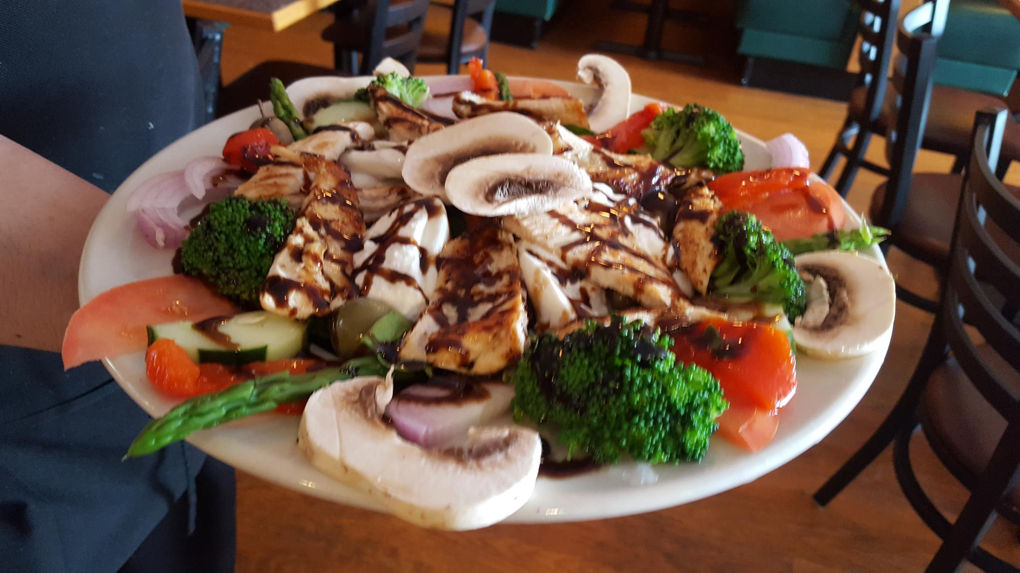 plate of chicken, fresh mozzarella, mushroom, red onion, tomato, broccoli and asparagus topped with balsamic drizzle