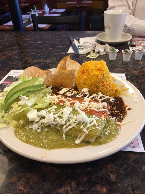 enchiladas with three difference sauces, a side of lettuce and rice with tortilla chips