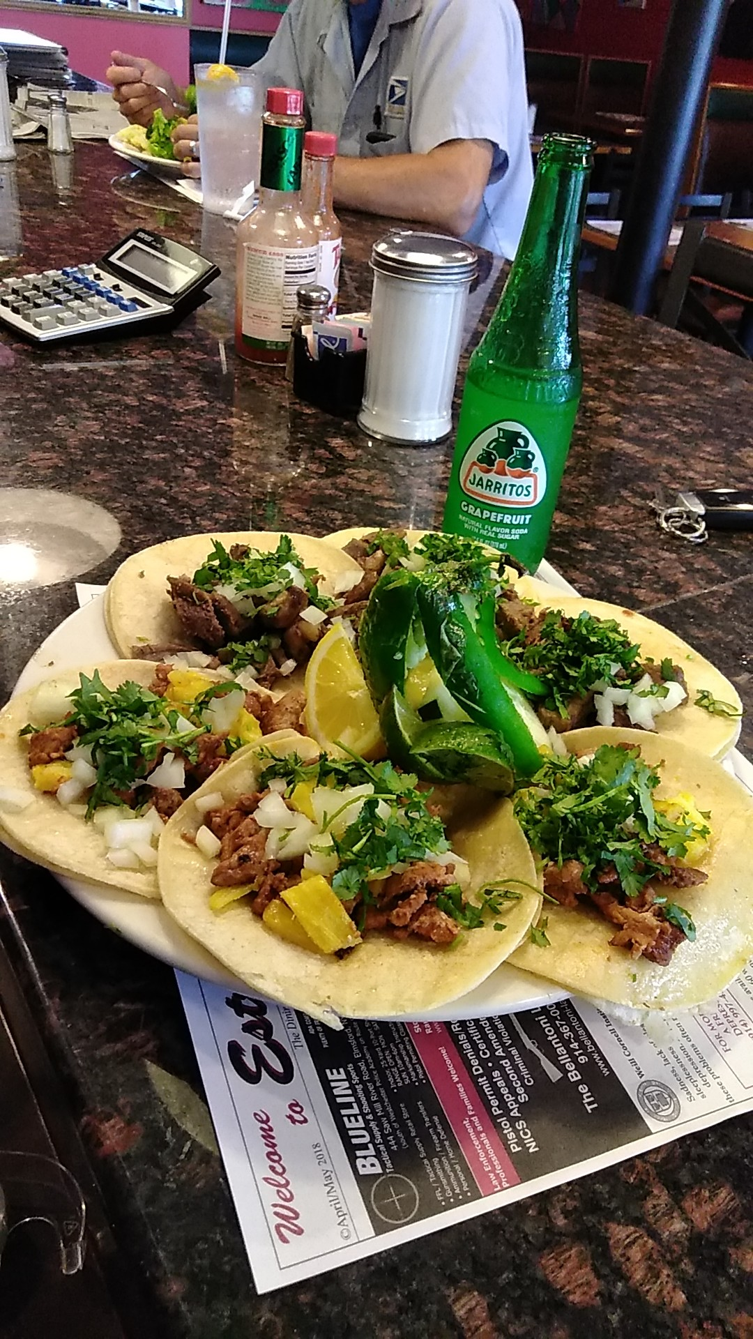 Six Tacos al Pastor or Lengua, soft tacos marinated pork with grilled pineapples or lengua with onions, cilantro, both served with rice & beans