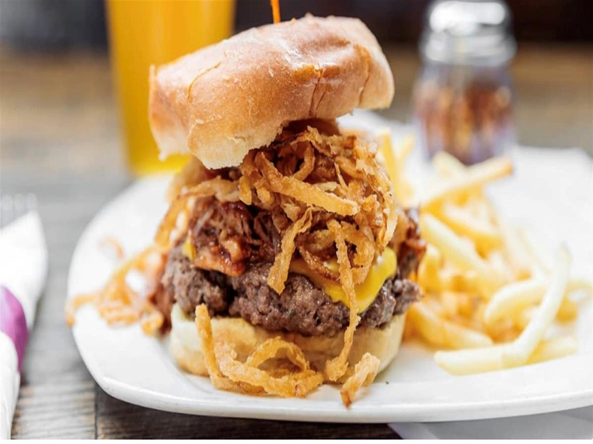 burger with onions and french fries