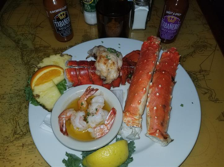 seafood dish with crab legs, lobster tail and shrimp
