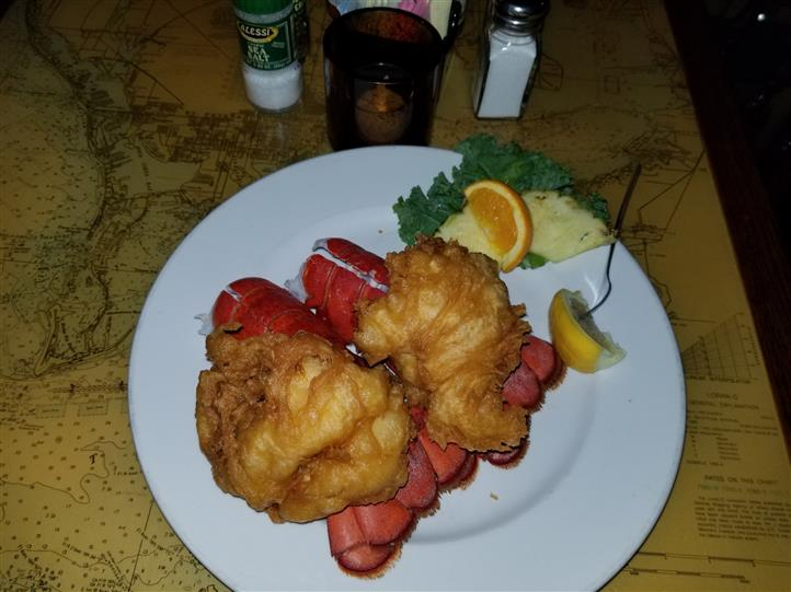 stuffed lobster tails on a plate