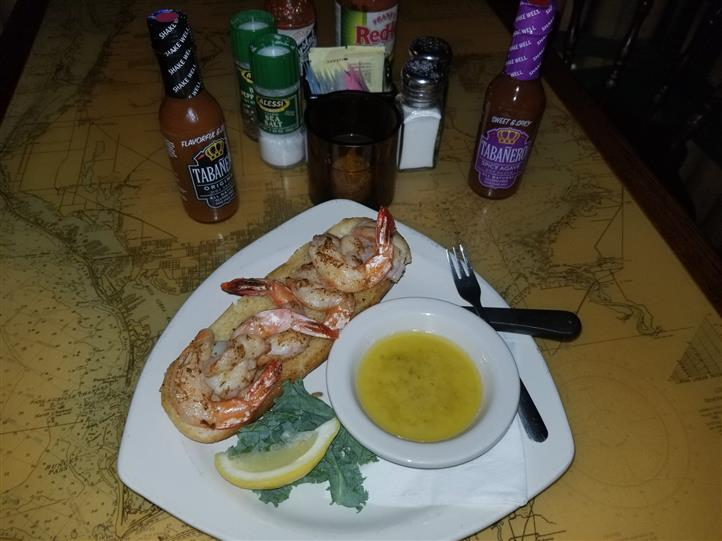 cooked shrimp on a roll with butter sauce