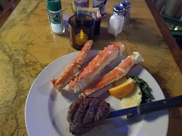 crab legs with steak andvegetables