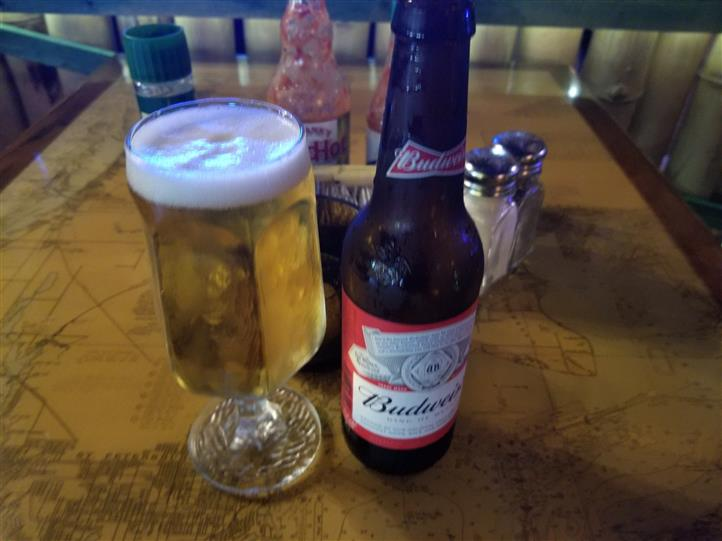 pint glass filled with Budweiser