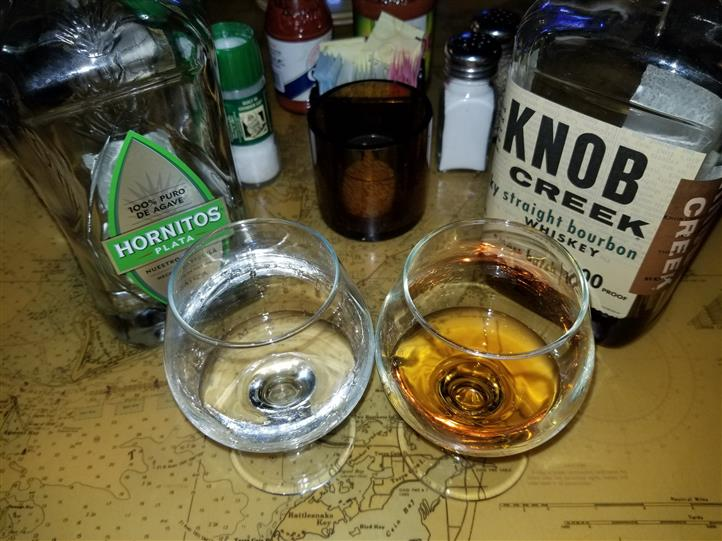 two glasses filled with hornitos and knob creek
