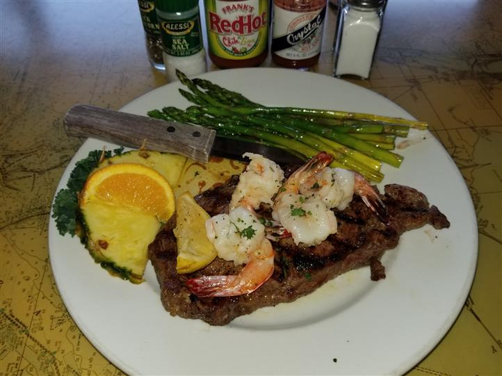 steak with cooked shrimp and asparagus