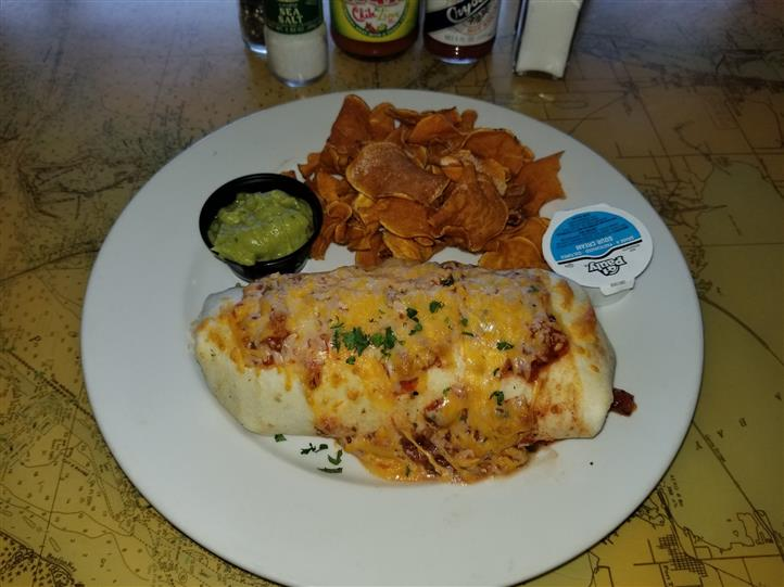 large burrito with cheese and sauce