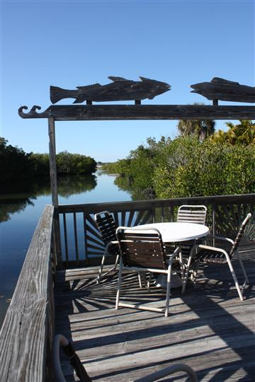 outdoor dock right off the water with table and chairs