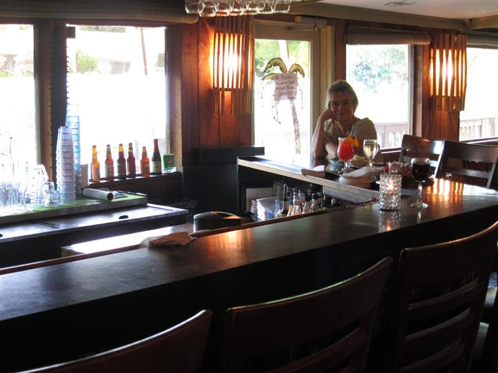 bar area with stools and customers
