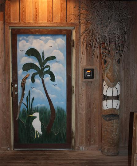 interior decorations on the wall with as tikis and paintings