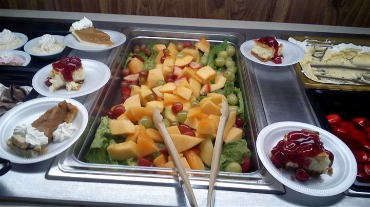 buffet assortment of fresh cut fruit and dessert pies