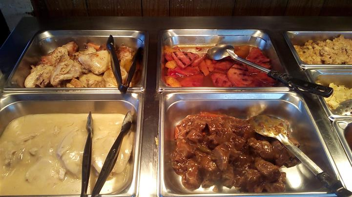buffet assortment of dinner dishes