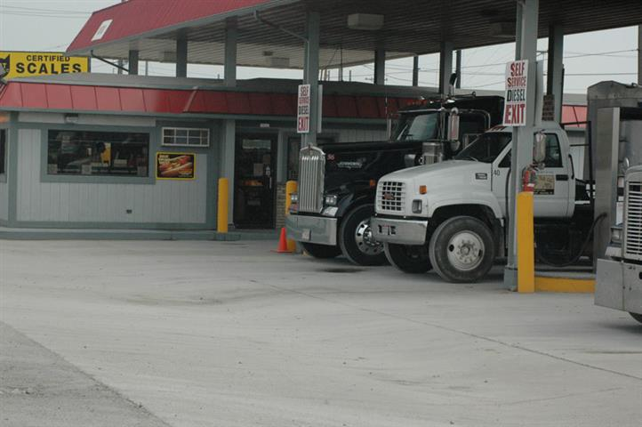 trucks filling up for gas at the pumps