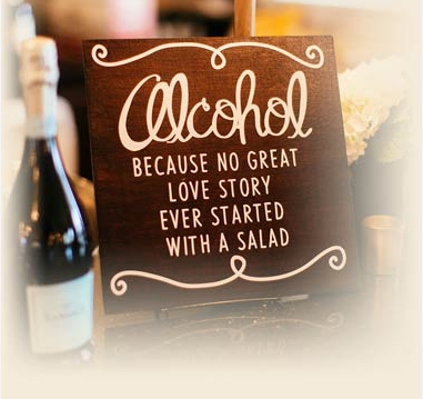 sign that reads alcohol because no great love story ever started with a salad