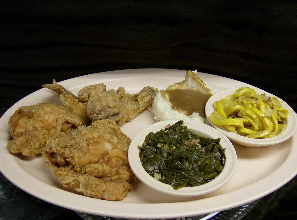 fried chicken with a side of mashed potatoes, and two sides of vegetables