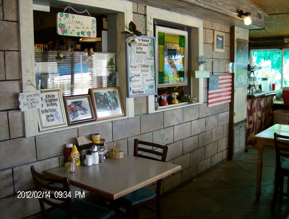 tables inside restaurant with photos on wall