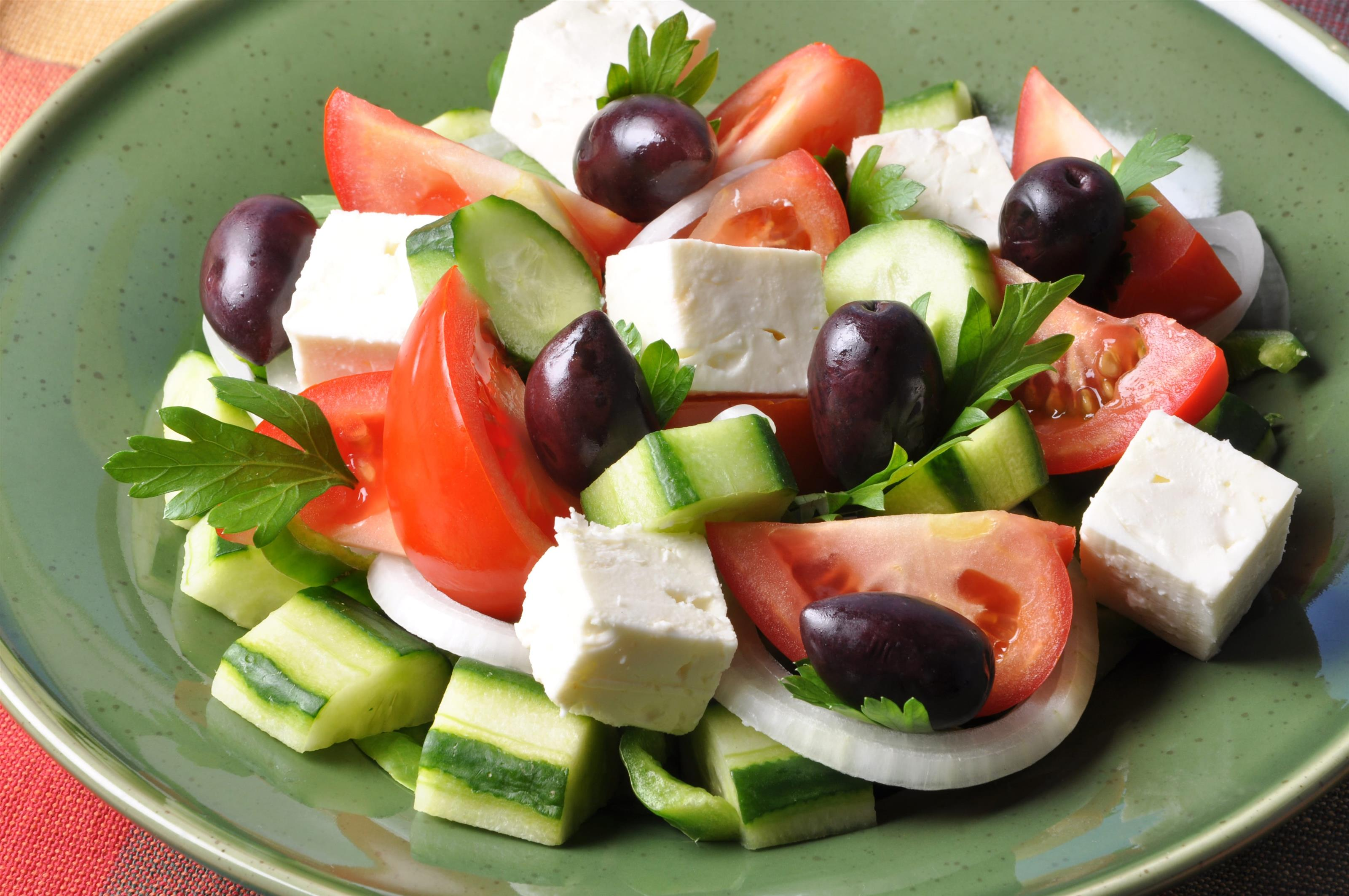antipasto salad with mozzarella, cucumber, olives, tomatoes, and onions