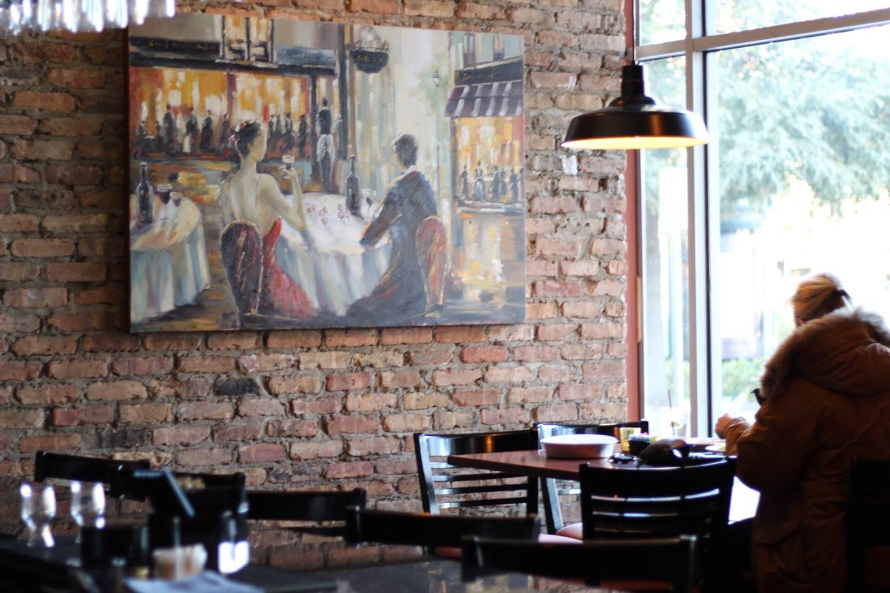 Inside of restaurant, dining room with chairs and art on the wall