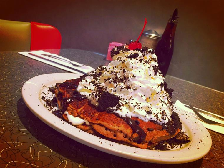Pancakes with whipped cream and oreo crumbs
