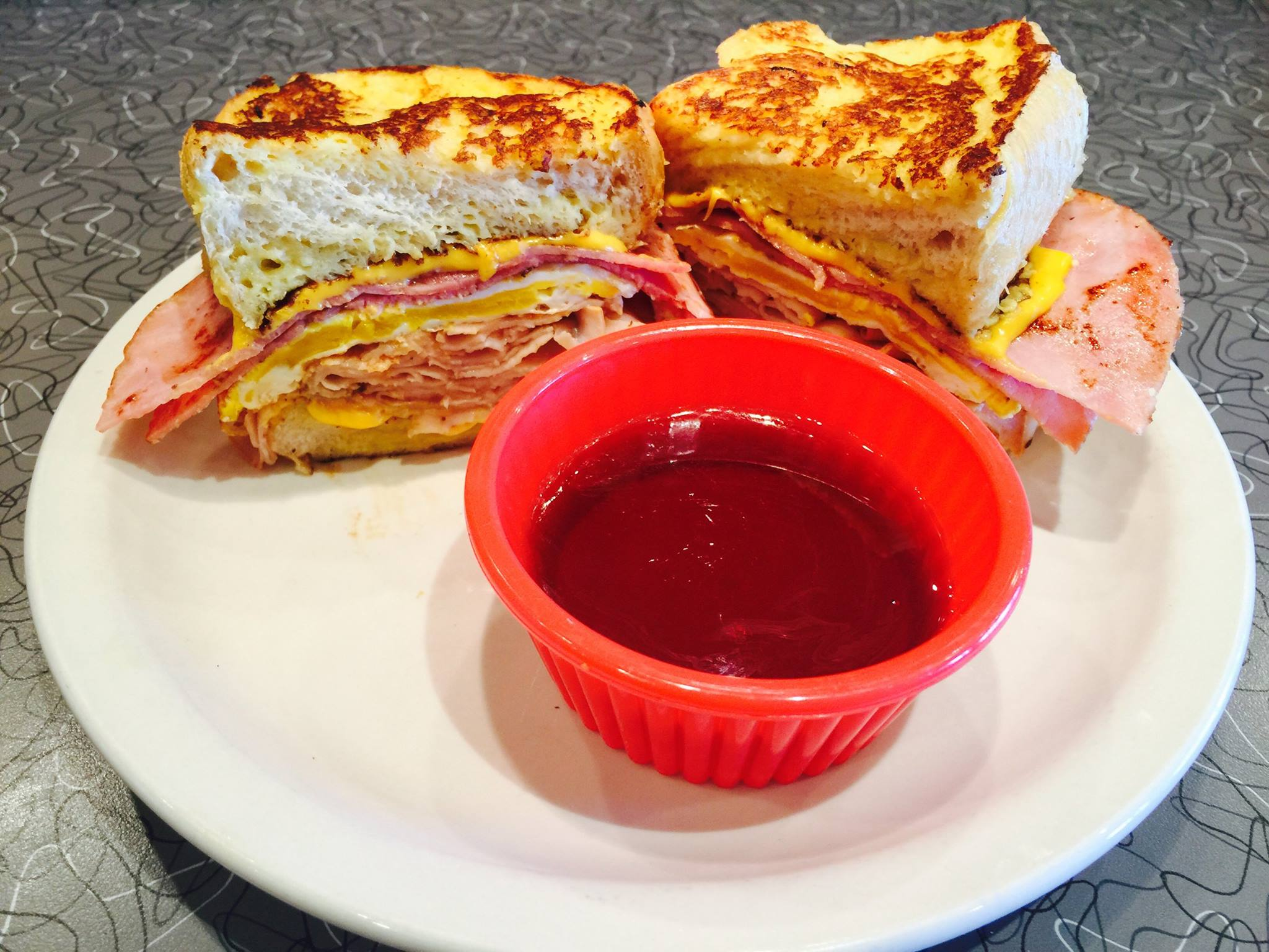 Ham sandwich with cheese and dipping sauce