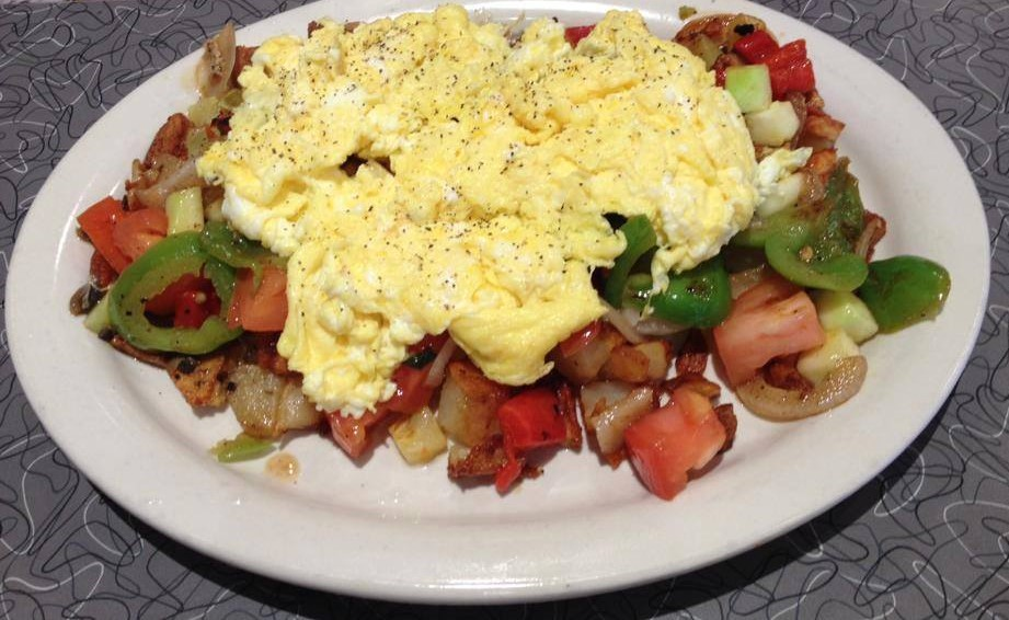 Vegetables with scrambled eggs on top