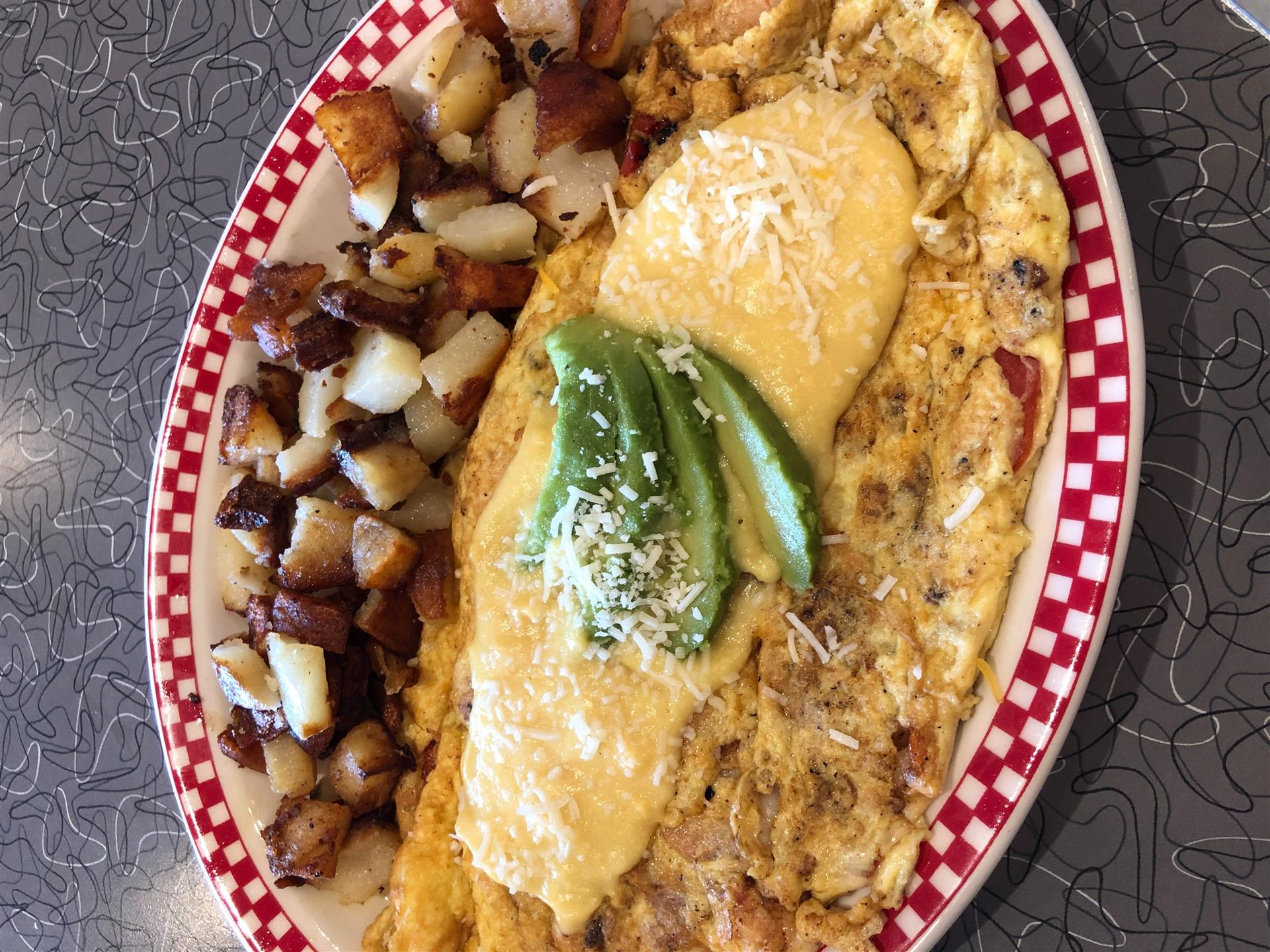 seafood omelet with a side of home fries