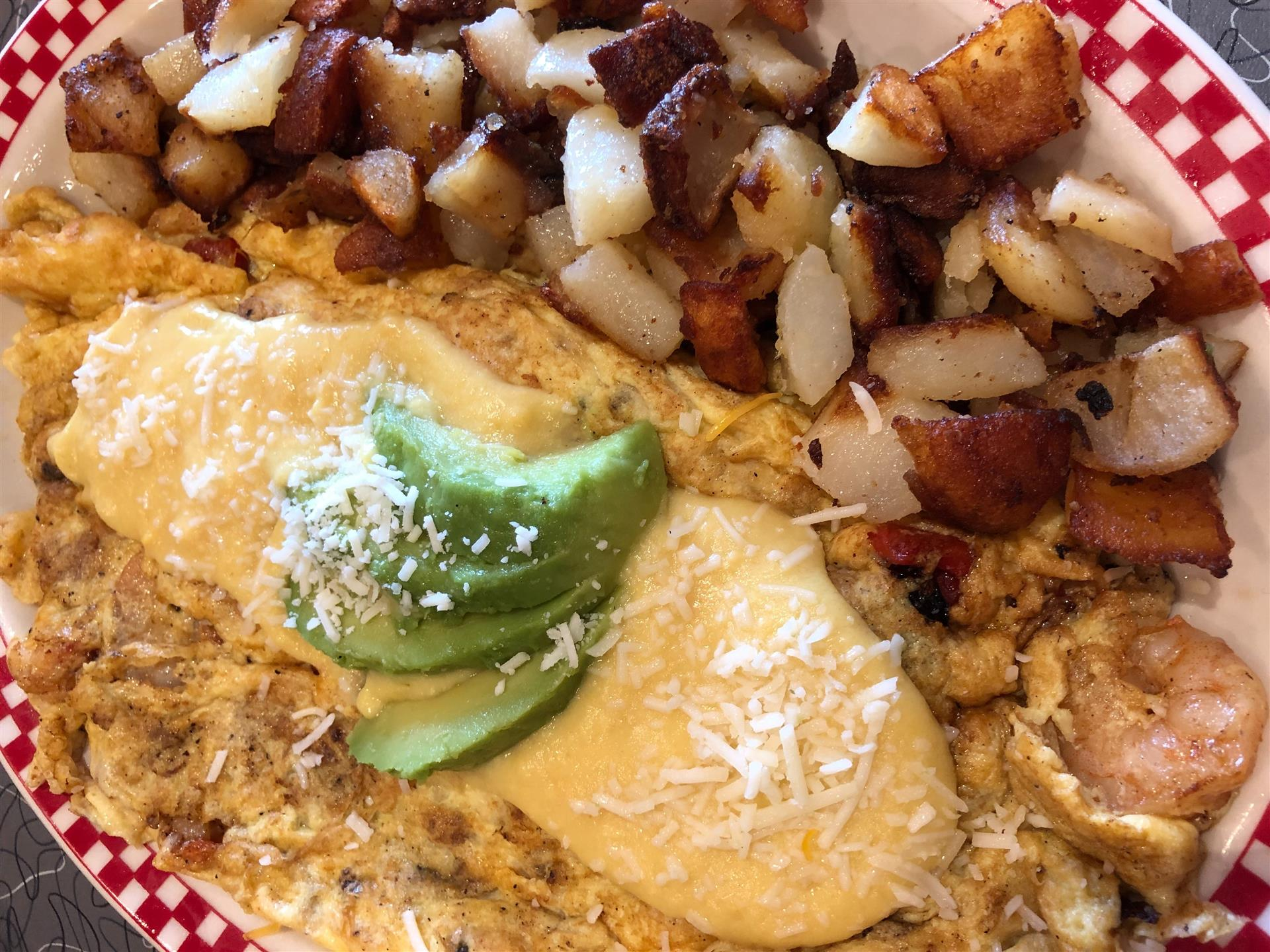 a seafood omelet with a side of home fries