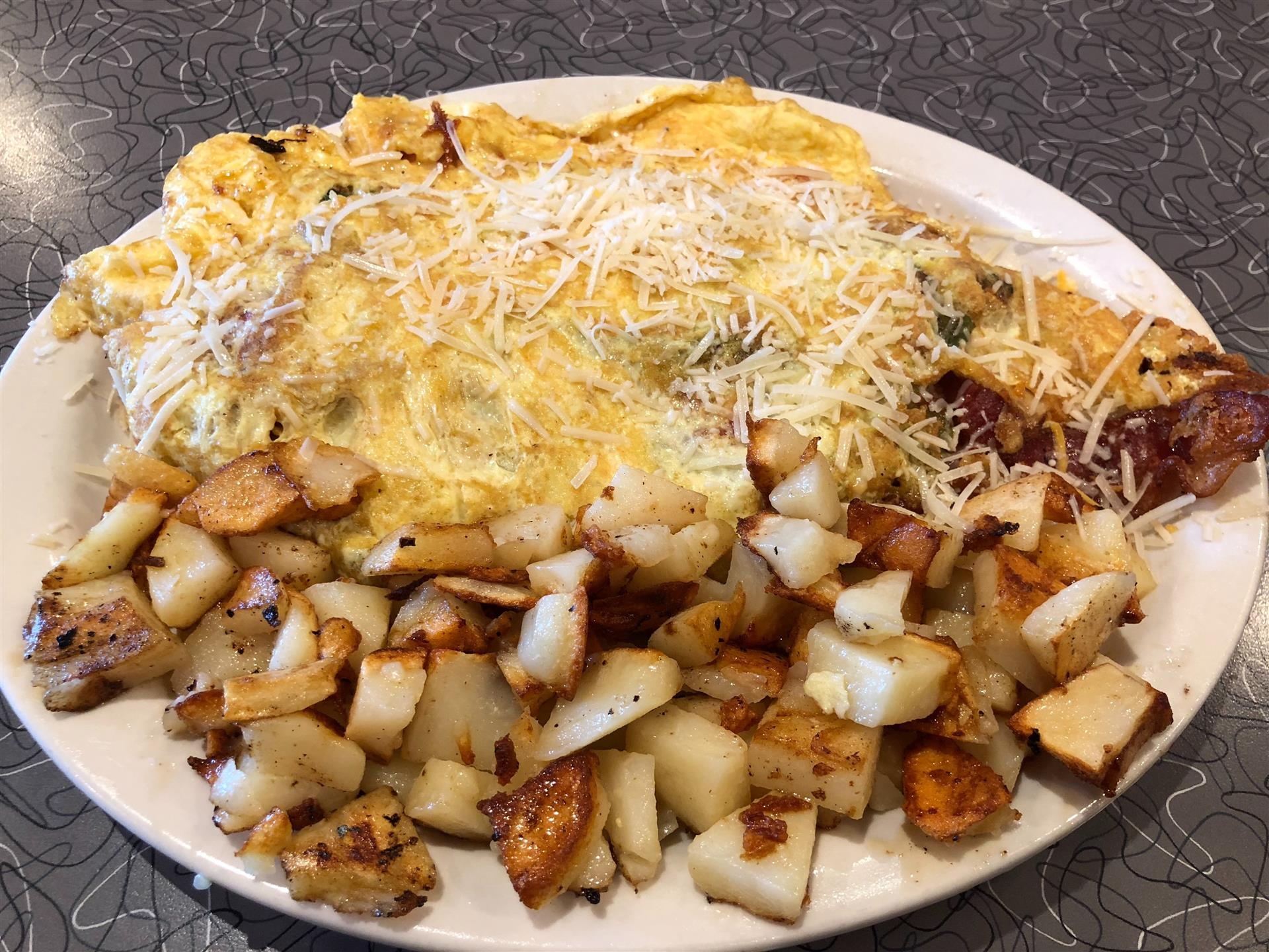 a breakfast omelet with a side of home fries