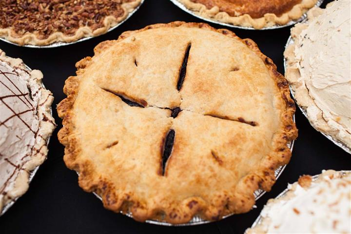 fresh apple pie along with other pies