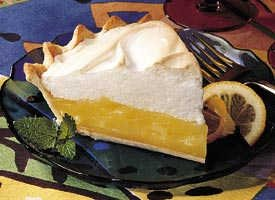 a slice of keylime pie with whipped cream