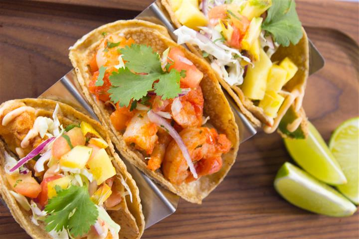 three shrimp tacos with coleslaw