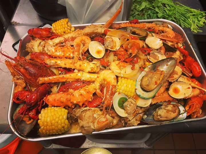 Snow crab legs, shrimp, crawfish, clams, mussels, corn and potatoes