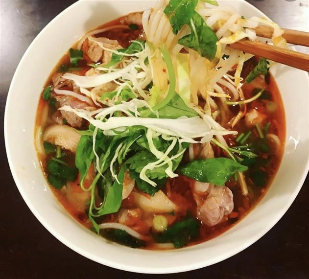 bowl of spicy chicken pho with chopsticks