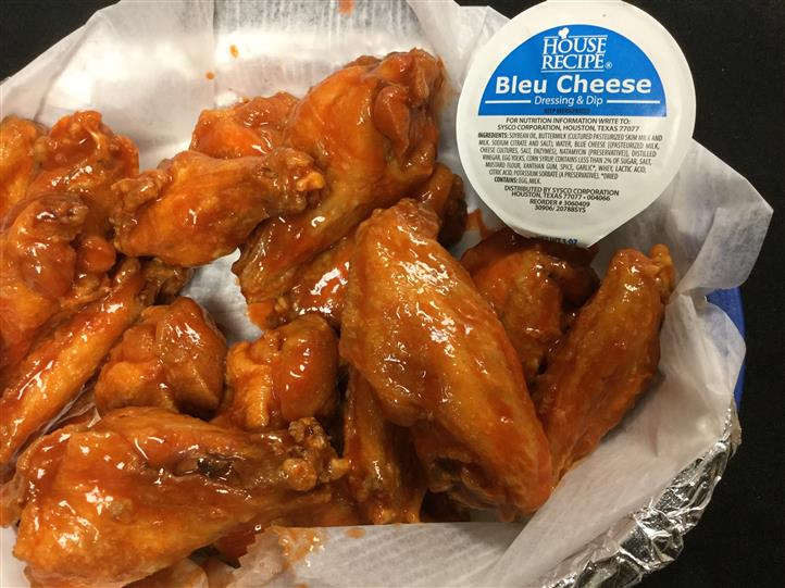 basket filled with buffalo wings and bleu cheese
