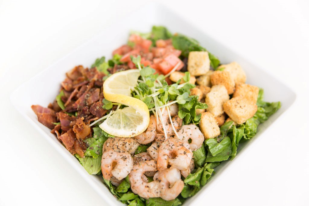 salad with bacon, shrimp, croutons, tomatos and lemons