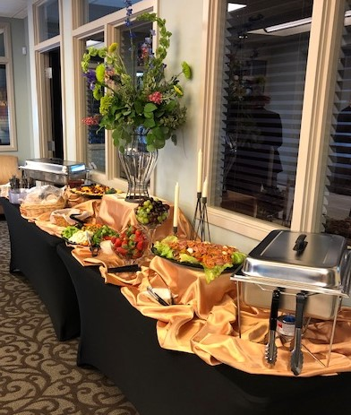 A catering table filled with a variation of food