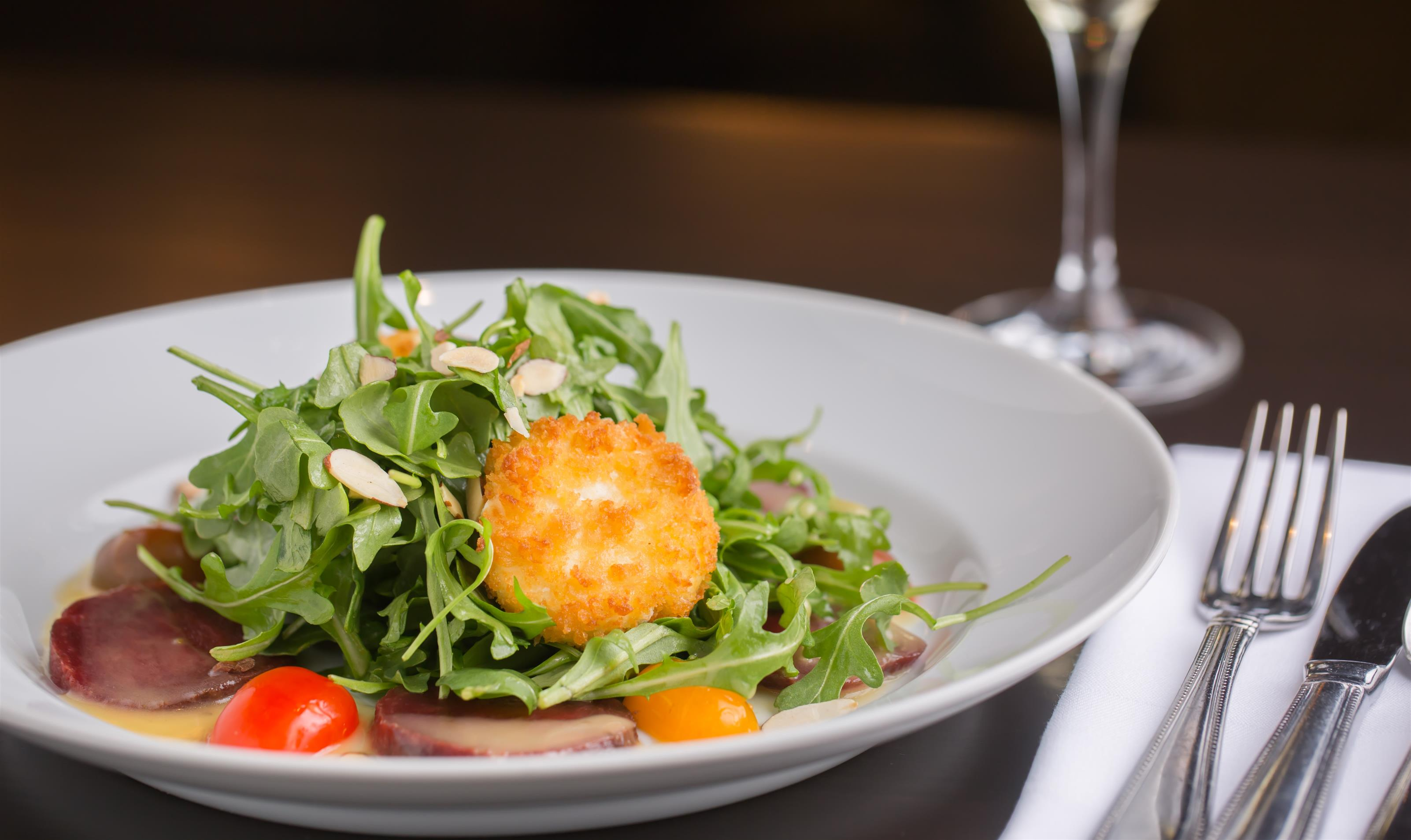 21 Lake Salad. arugula. flash fried goat cheese. beets. tomatoes. almonds. honey citrus vinaigrette.