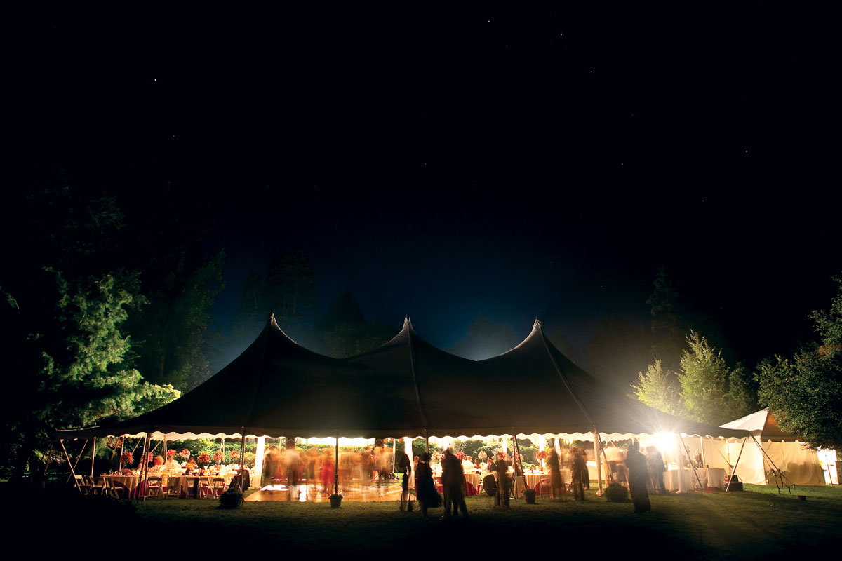 event tent lit up at night