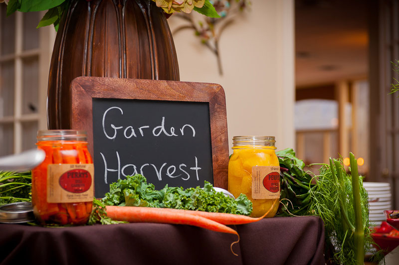 garden harvest sign on a table with vegetables