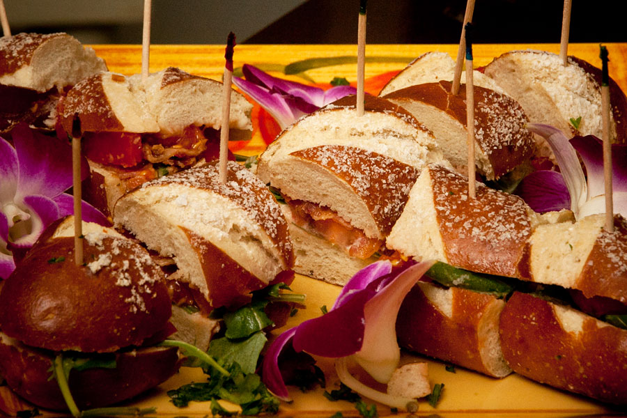 sandwiches on pretzel bread served on a platter